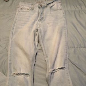 High waisted light wash ripped jeans